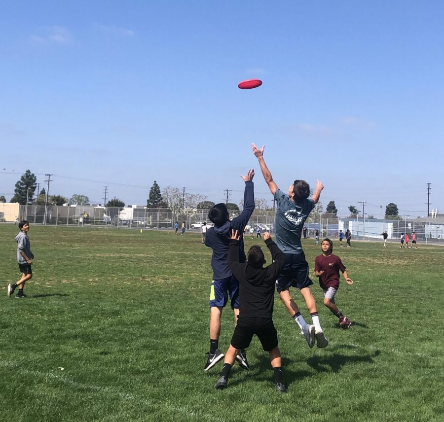 McAuliffe Middle School students playing Ultimate Frisbee.
