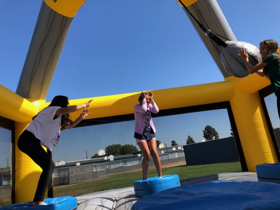McAuliffe students jumping in a bounce house at the Day of Awesomeness for Step It Up.