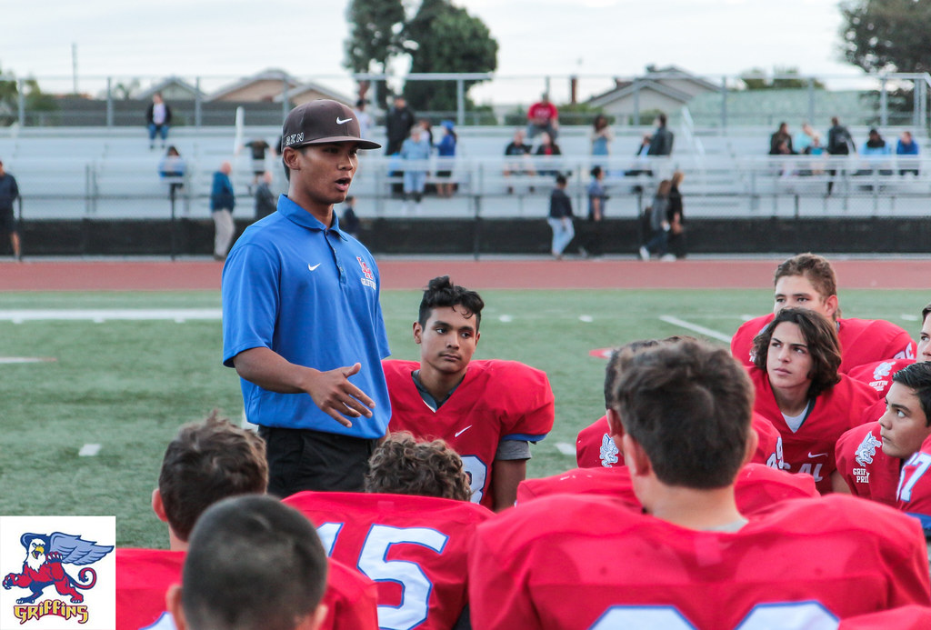 Coach talking to his players.