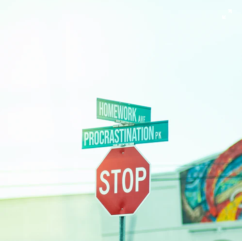 Procrastination street sign.