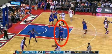 This Knicks player is not playing defense on a Pistons player in the last seconds of the third quarter, leaving him wide open for a three-pointer, while they were losing by eight points.