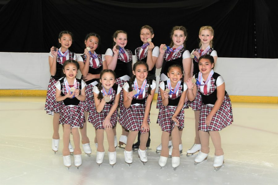 Tracy Nguyen and Sienna Wu's skating team photo.