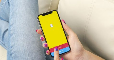 This iPhone screen shows someone logging into Snapchat.