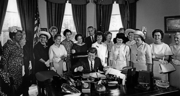 John F. Kennedy signing the Equal Pay Action