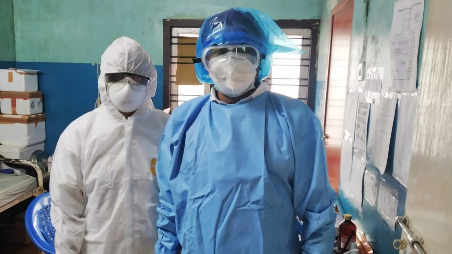 Healthcare workers wearing masks and scrubs
