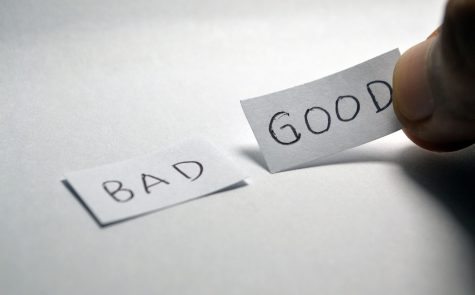 Two slips of paper that say bad and good.