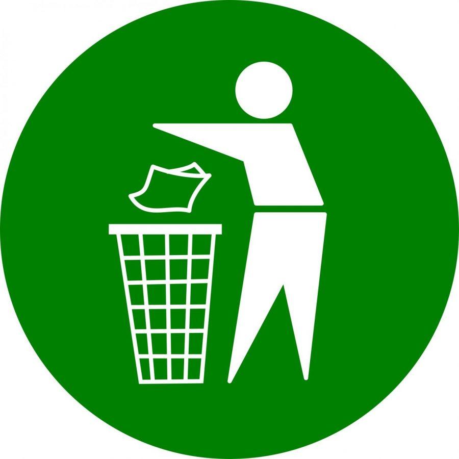 Man emptying trash in a trash can