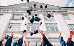 Graduating students throwing their hats.