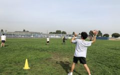 Students playing catch during hybrid PE.
