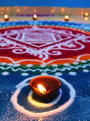 A diya and rangoli.