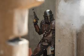 The Mandalorian, poised for action, during one of the episodes.