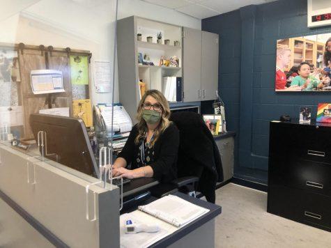 Mrs. Johnson at her desk.