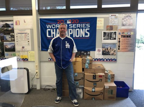 Mr. Bay standing in front of his LA Dodger Champion sign.