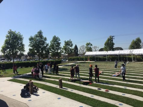 Students playing with the lawn games at the outdoor amphitheater